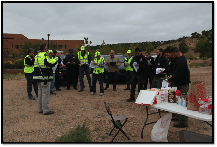 Members of public agencies in a pre-exercise briefing with the Emergency Manager.