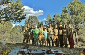 Southwest Conservation Corps crew stands with a couple that received defensible space work through the low-income pilot program. Photo by Rebecca Samulski