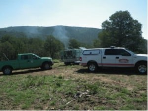 Resources from Federal agencies and local fire departments staged for the prescribed burn. Photo Credit Mike Caggiano