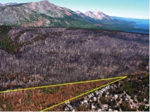 The aftermath of the 2007 Angora Fire. The highlighted area shows the location of a forest thinning project, where the fire changed from a crown fire to a lower-intensity surface fire. Nearby homes were still impacted by embers. Photograph from R5-TP-025, USDA Forest Service.
