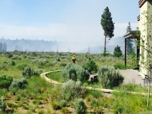 Firefighter patrolling for spots during the Shevlin Fire. Photo Credit: KTVZ
