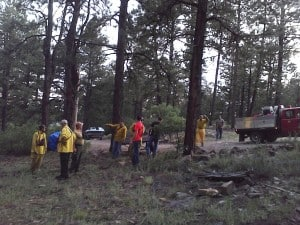 Earlier this summer, an Ambassador arranged for the Mancos Volunteer Fire & Rescue to conduct a training exercise in his neighborhood. Above, they make plans for their triage exercise. Photo Credit: Rebecca Samulski