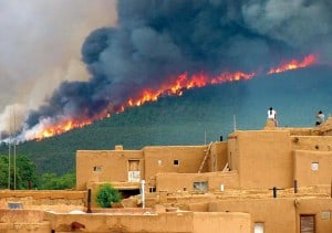 A photo from the Carson National Forest taken during the 2003 Encebado Fire on Taos Pueblo. Photo Credit: Ignacio Peralta, USFS.