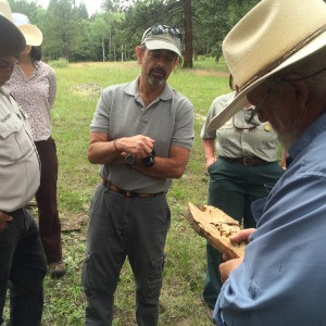 Taos Valley Watershed Coalition partners examine fire scars with Dr. Tom Swetnam. Photo Credit: Garret VeneKlasen