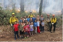 Students from two local grade schools came out to this burn near the Salmon River to learn about prescribed burning and traditional food and fiber resources that benefit from these practices. Photo credit: Stormy Staats