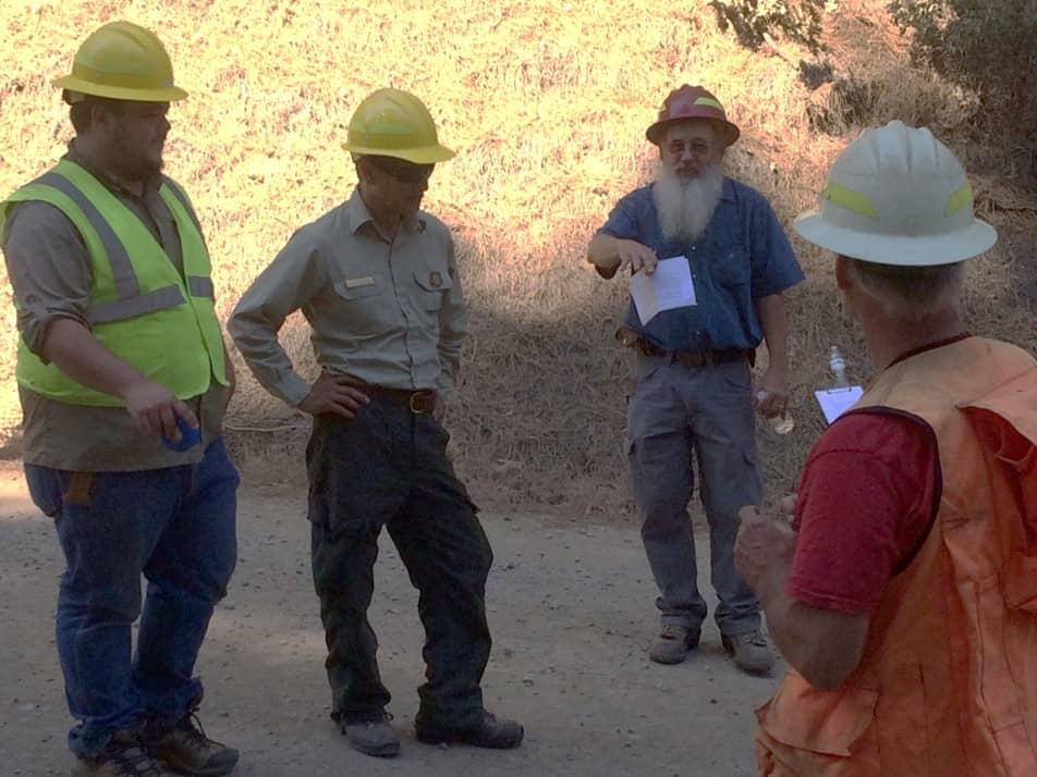 Four participants having a field discussion.