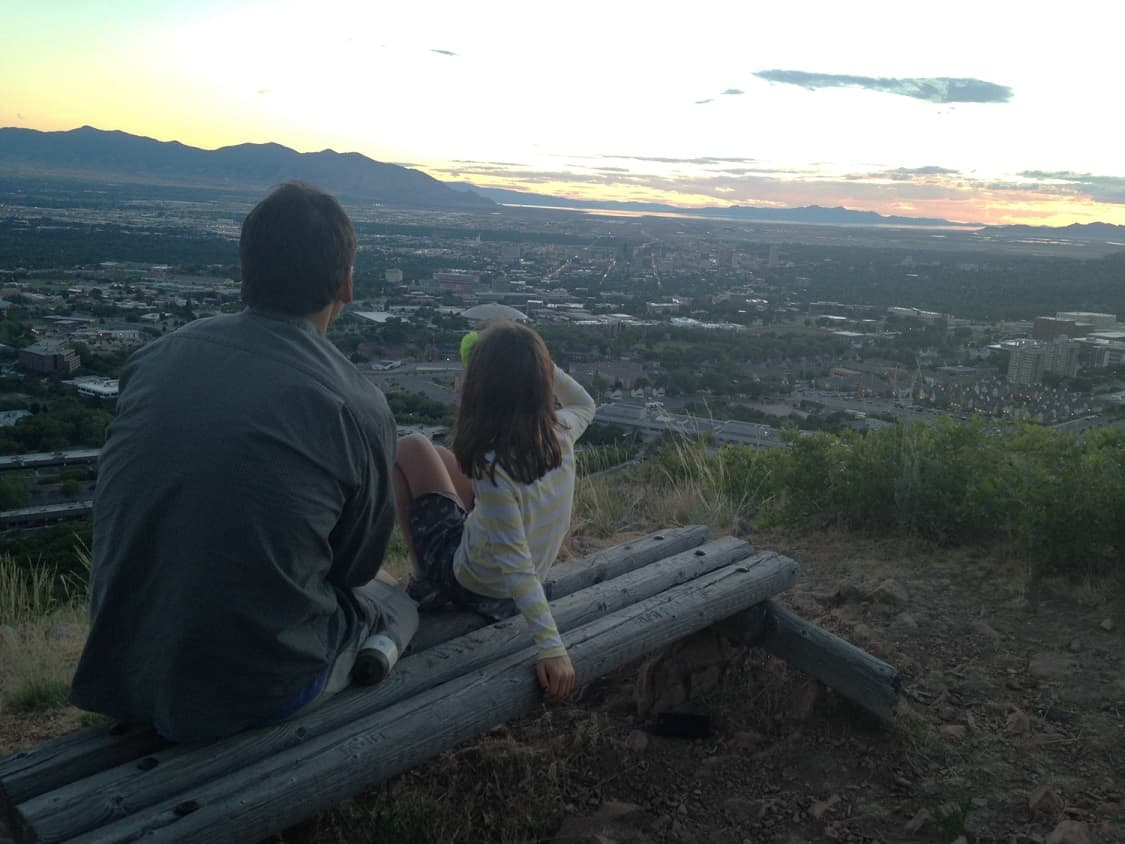 Maria's family watching the sunset over Salt Lake City.