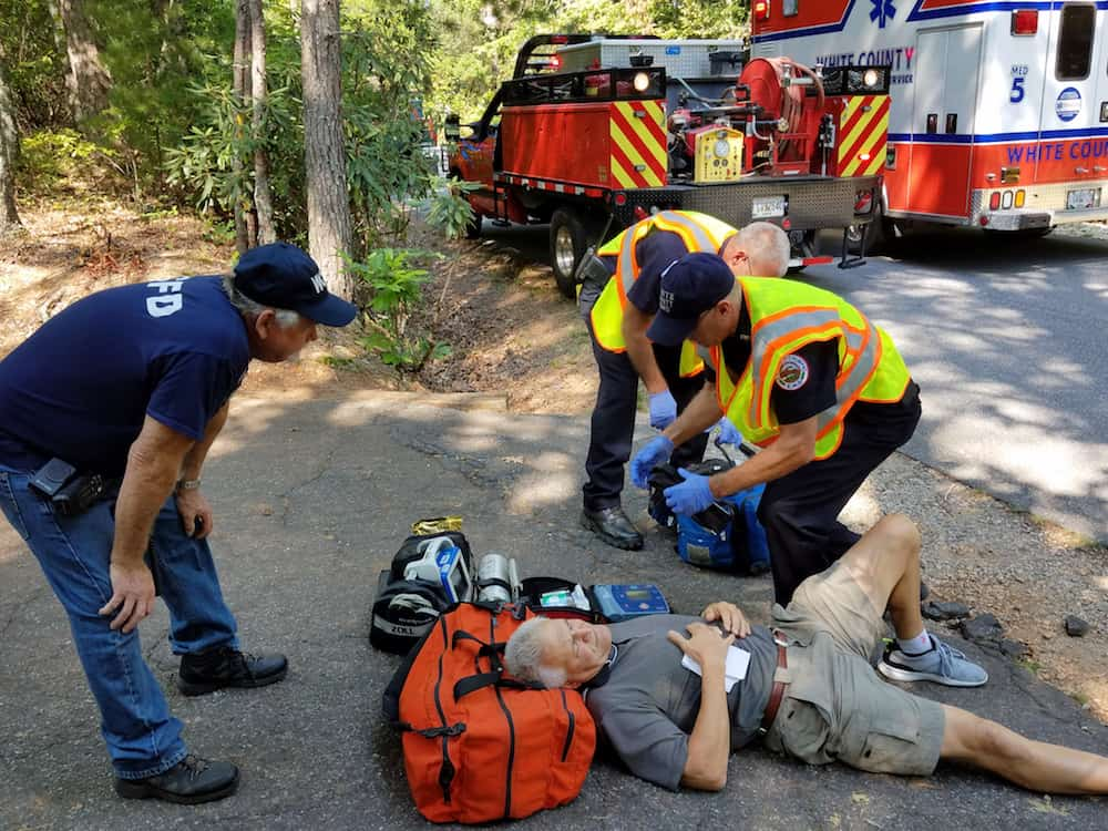 "Residents were part of the scenario including this ""heart attack"" victim. Credit: Frank Riley"