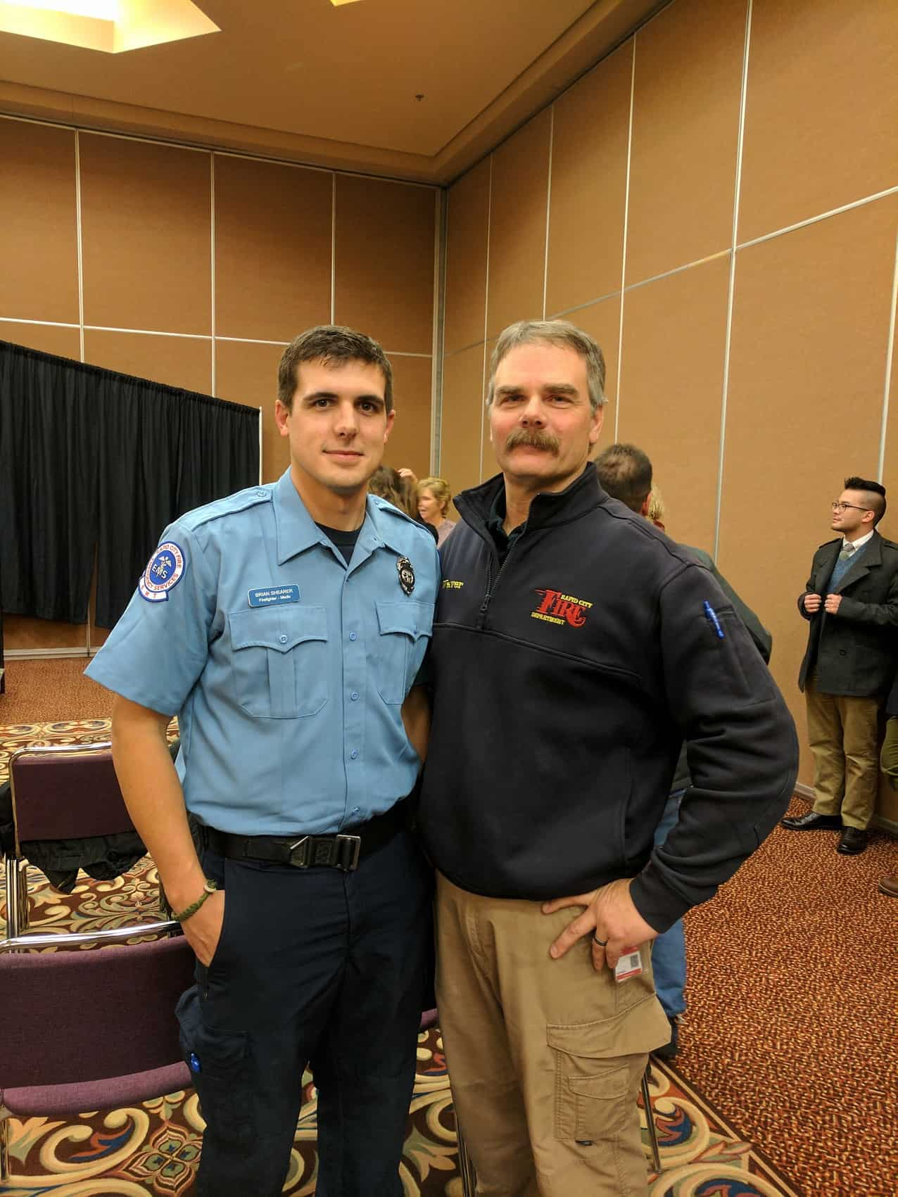 Brian and Tim at Brian's Fire Academy graduation ceremony. Credit: Tim Weaver