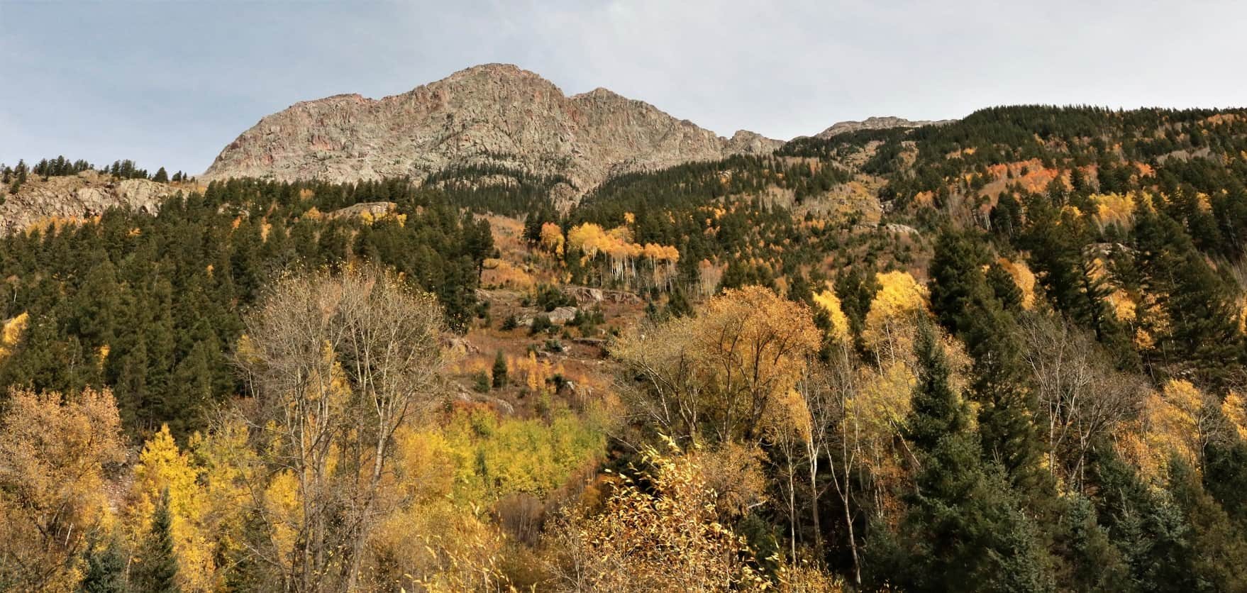 Landscape view of San Jaun Mountain outcroppings with fall foliage.
