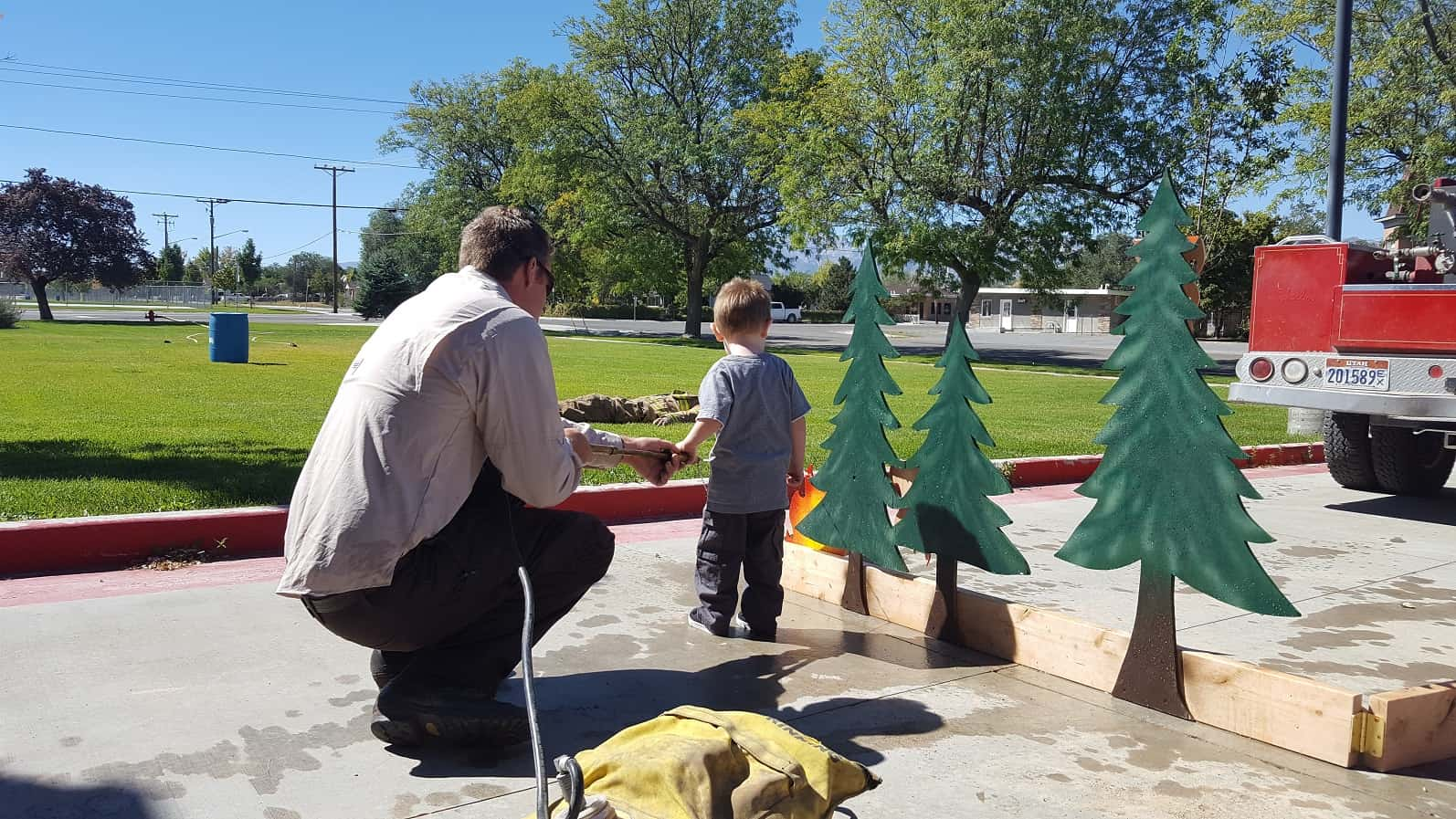 Child playing with wildfire display at a FAC outreach event.