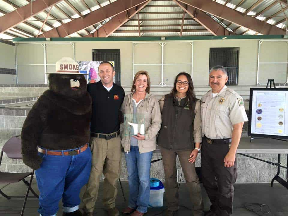 Group photo of Smokey Bear and staff