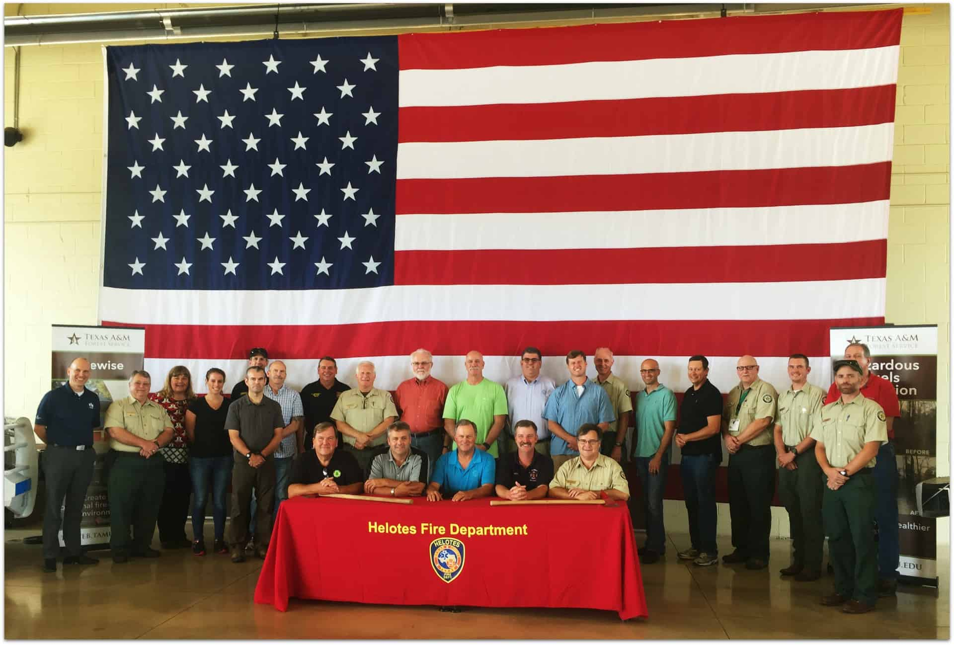 Group photo of IAFC meeting participants, where USAA shared fire adapted communities strategies.