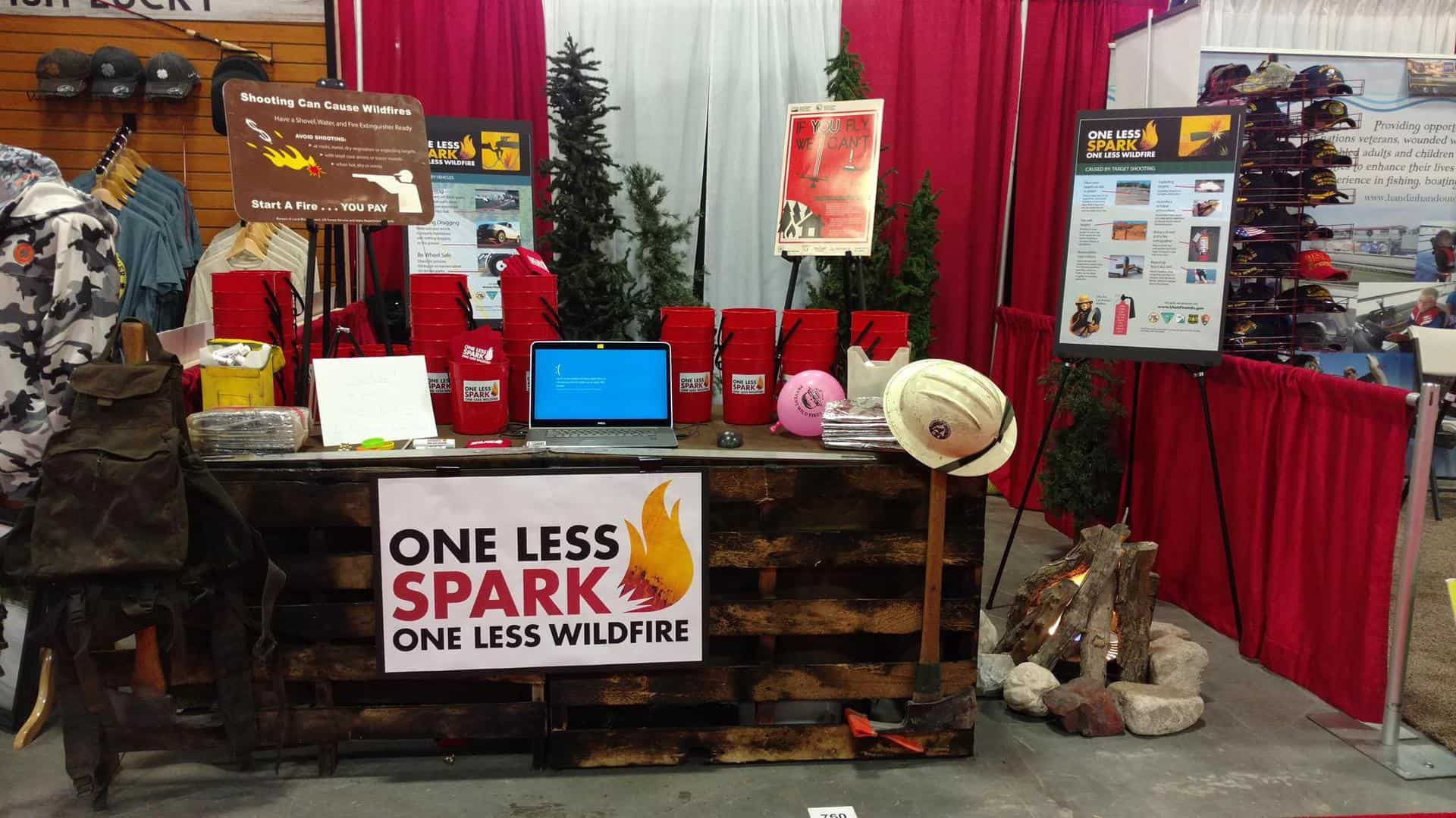 "A ""One Less Spark"" outreach booth"