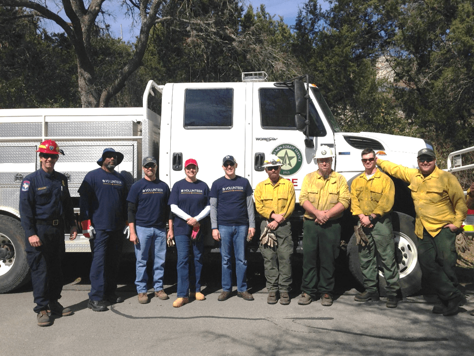 USAA volunteers and an inter-agency crew in a group photo.