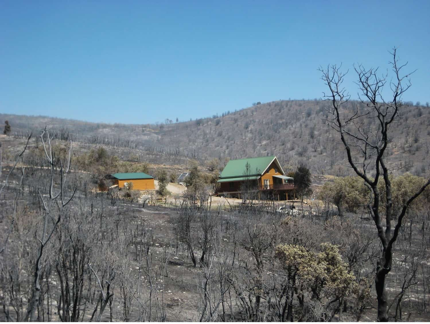 Lone home remaining in an otherwise burnt area. Damage like this inspired Utah's new wildfire policy.