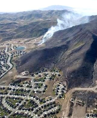 Aerial view of a wildfire burning in the wildland-urban interface
