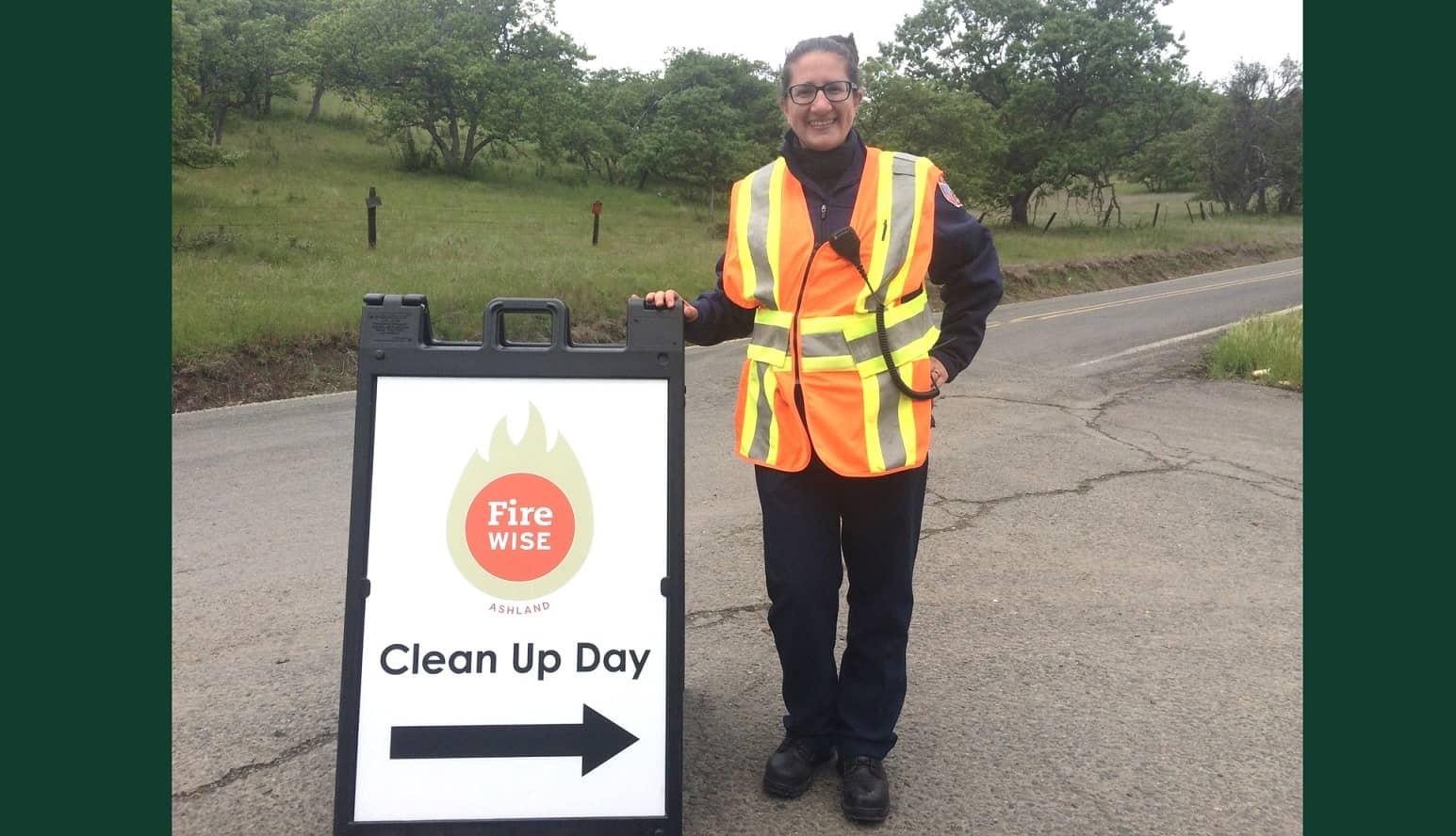 Alison Lerch by a Clean-Up Day sign