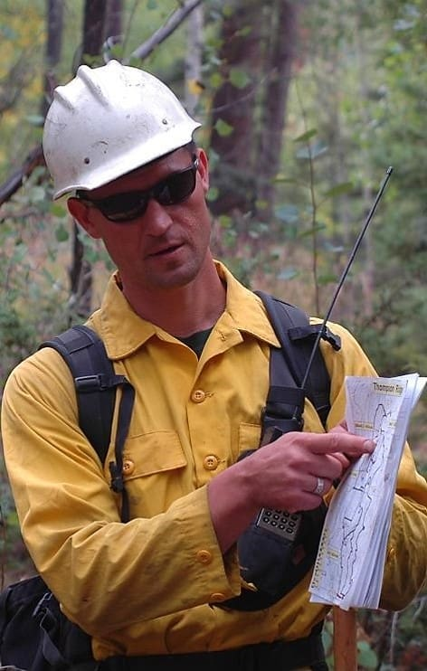 Jeremy Bailey leading a prescribed fire briefing