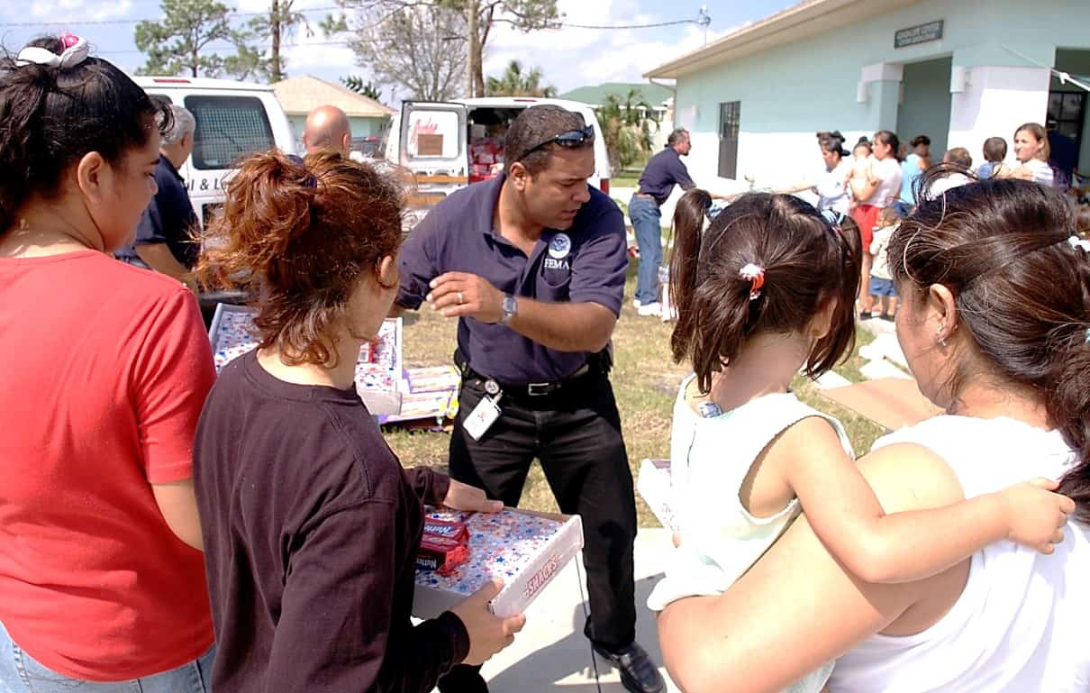 FEMA worker distributing supplies to families