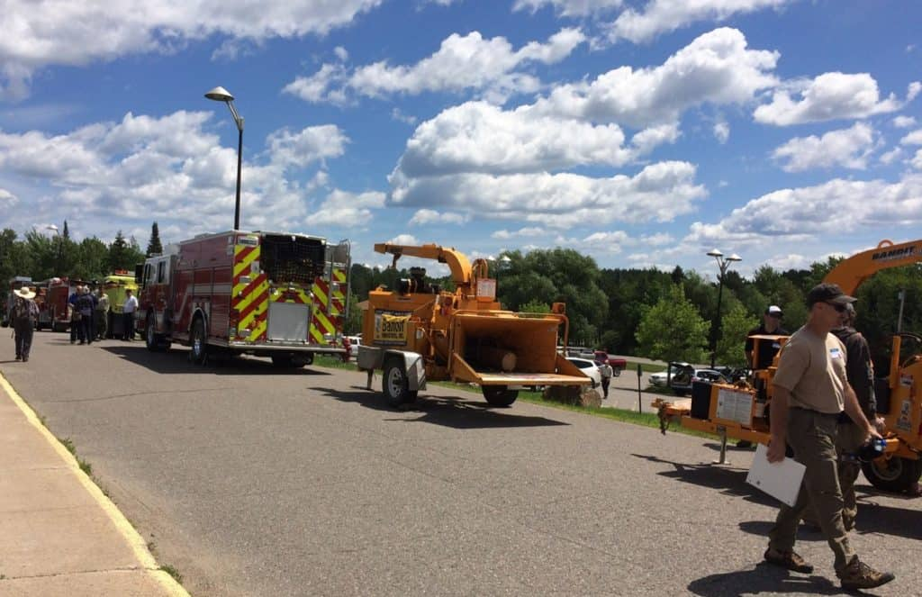 Firetrucks and chipping equipment on display at the outreach event