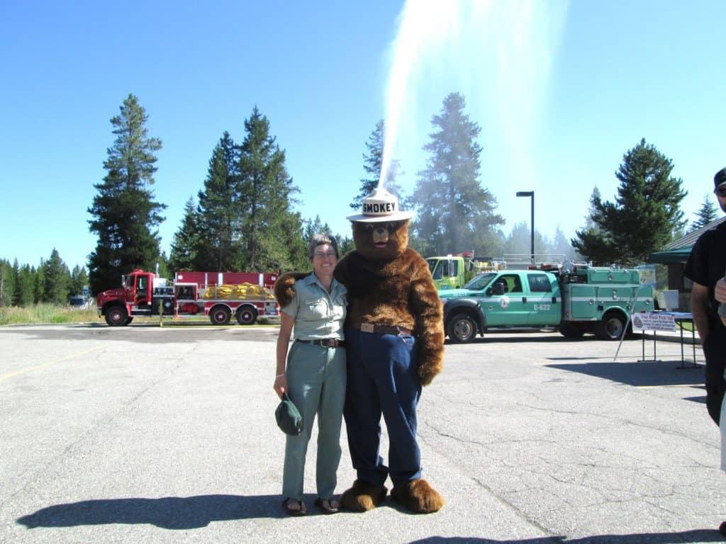 Liz posing with Smokey the Bear