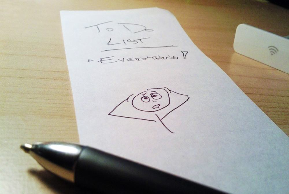 """A pen and a to-do list, reading, """"To do list: Everything!"""""""