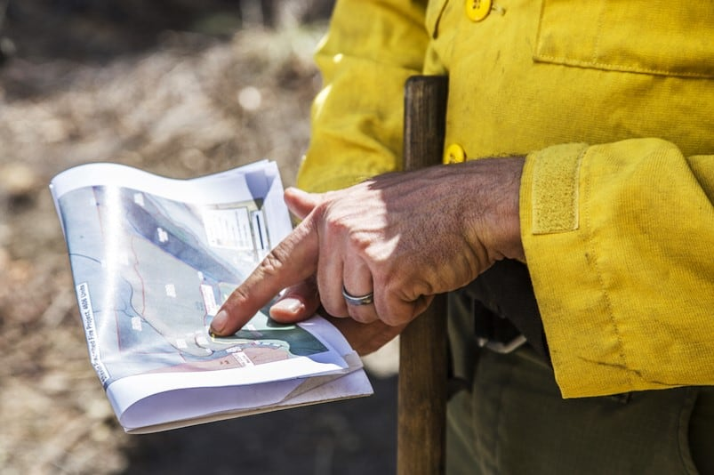 Firefighter pointing to a map