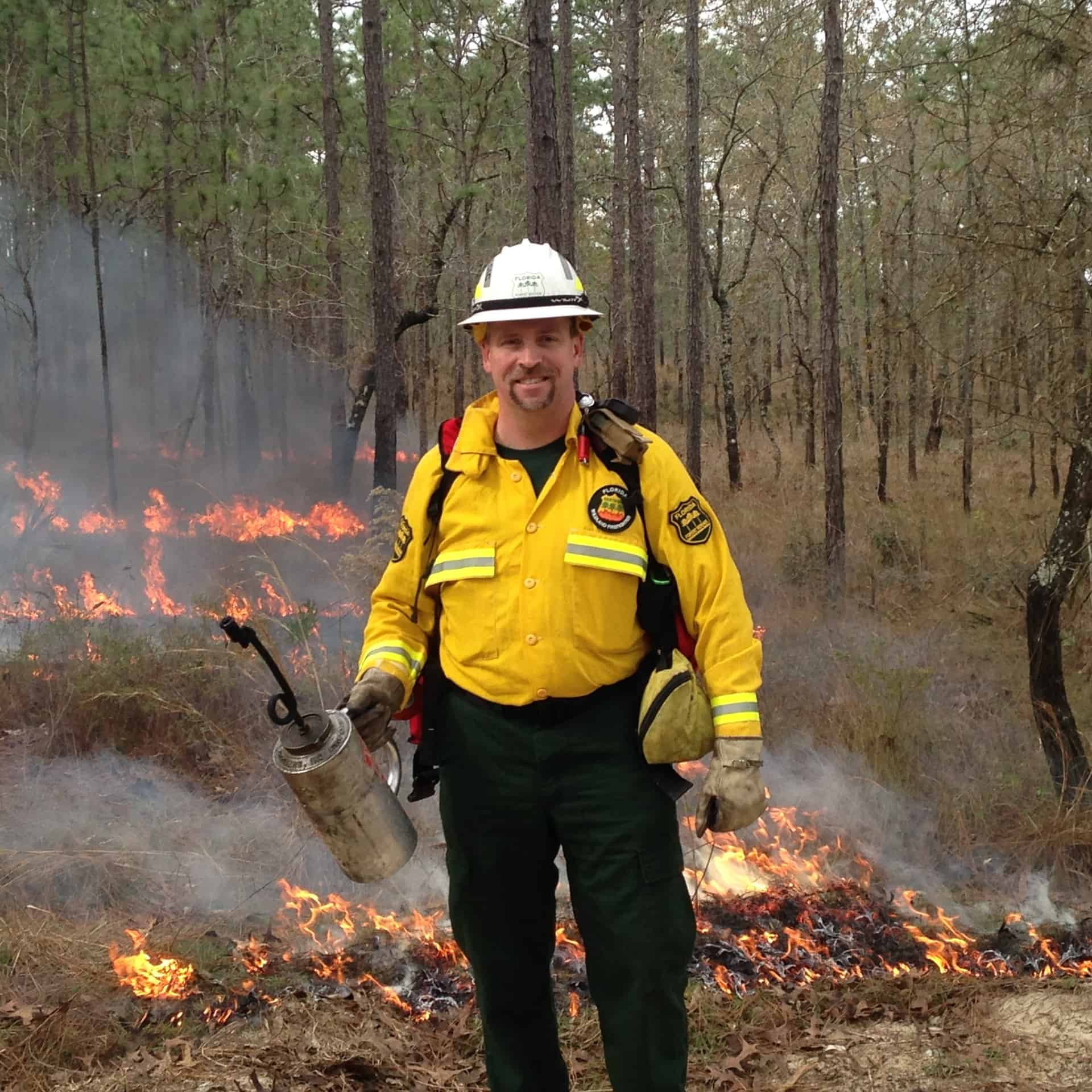 John Fish with a drip torch. John is the chief of the Florida Forest Service, and has represented the National Association of State Foresters (NASF) on the National Wildfire Coordinating Group's WUI Committee and currently on the national Fire Adapted Communities Coalition.