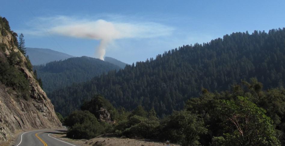 Wildfire smoke inversion occurring on the horizon; temperature inversions trap smoke