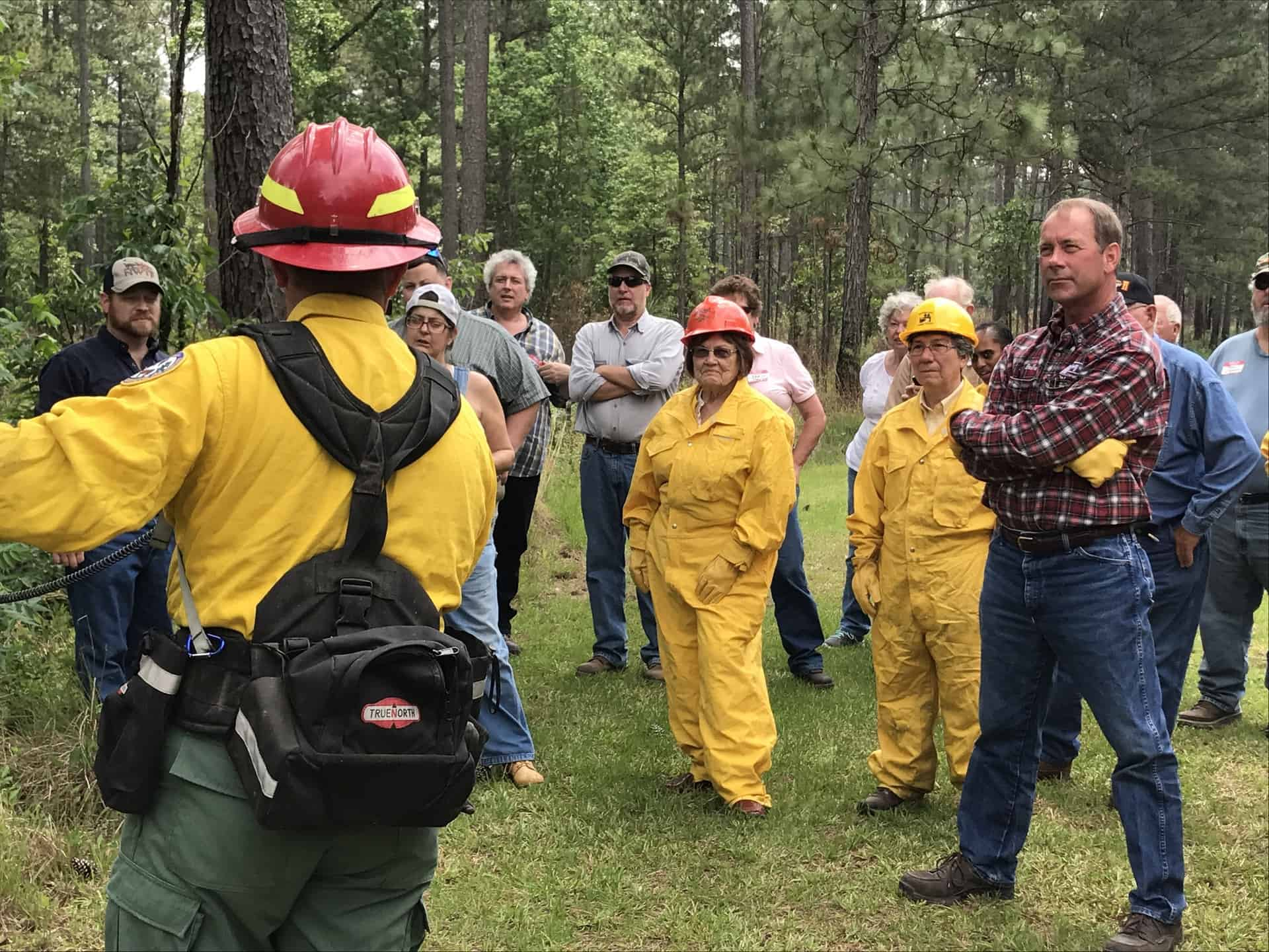 Prescribed fire practitioner explaining the process of controlled burning to the public