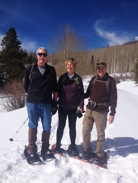 Pam, her husband and her brother snowshoeing