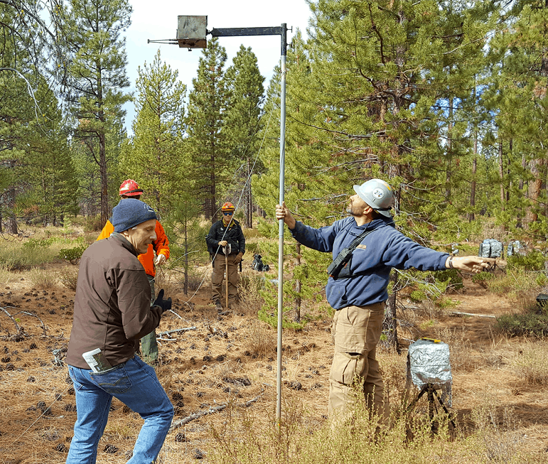 Monitoring team setting up equipment in the field