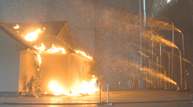 Home being ignited by artificially distributed embers
