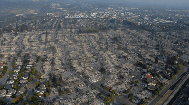 Aerial view of Santa Rosa after the 2017 wildfire season, showing some homes destroyed, others untouched