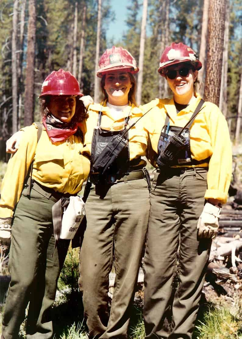 Three female firefighters in uniform