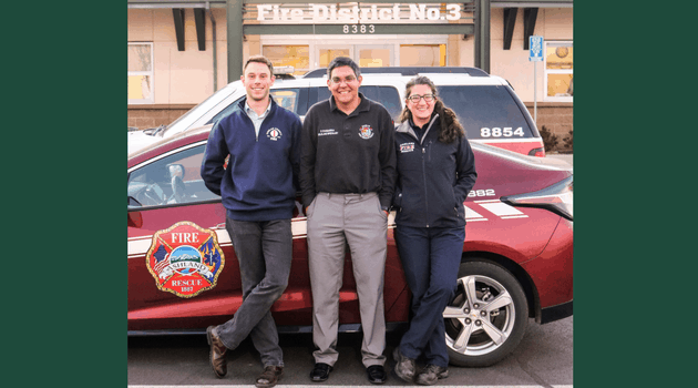 Three FAC Net members outside of a fire department