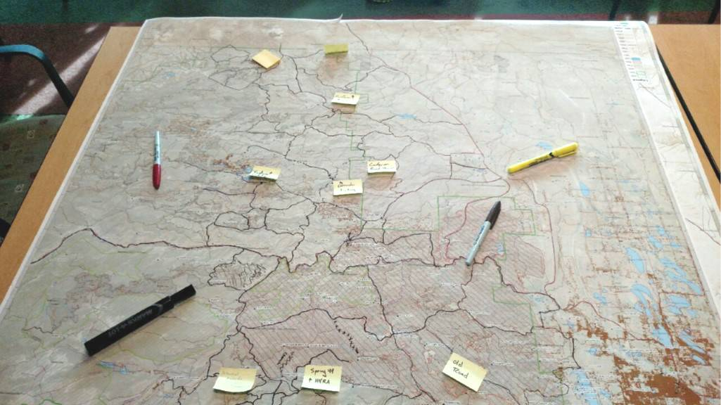 Map with hand-drawn polygons and post-it notes on it