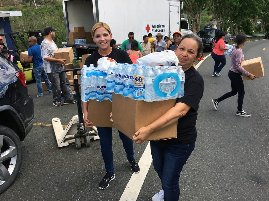 Volunteers unloading food and water