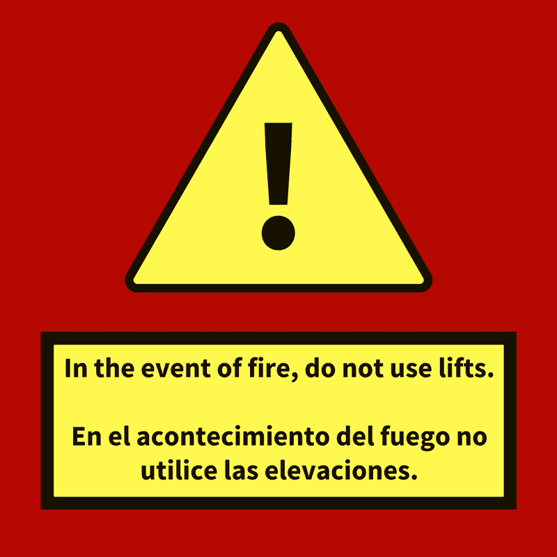 "A sign that reads ""In the event of fire, do not use lifts,"" and ""En el acontecimiento del fuego no utilice las elevaciones."" Let's make higher caliber wildfire resources in Spanish"