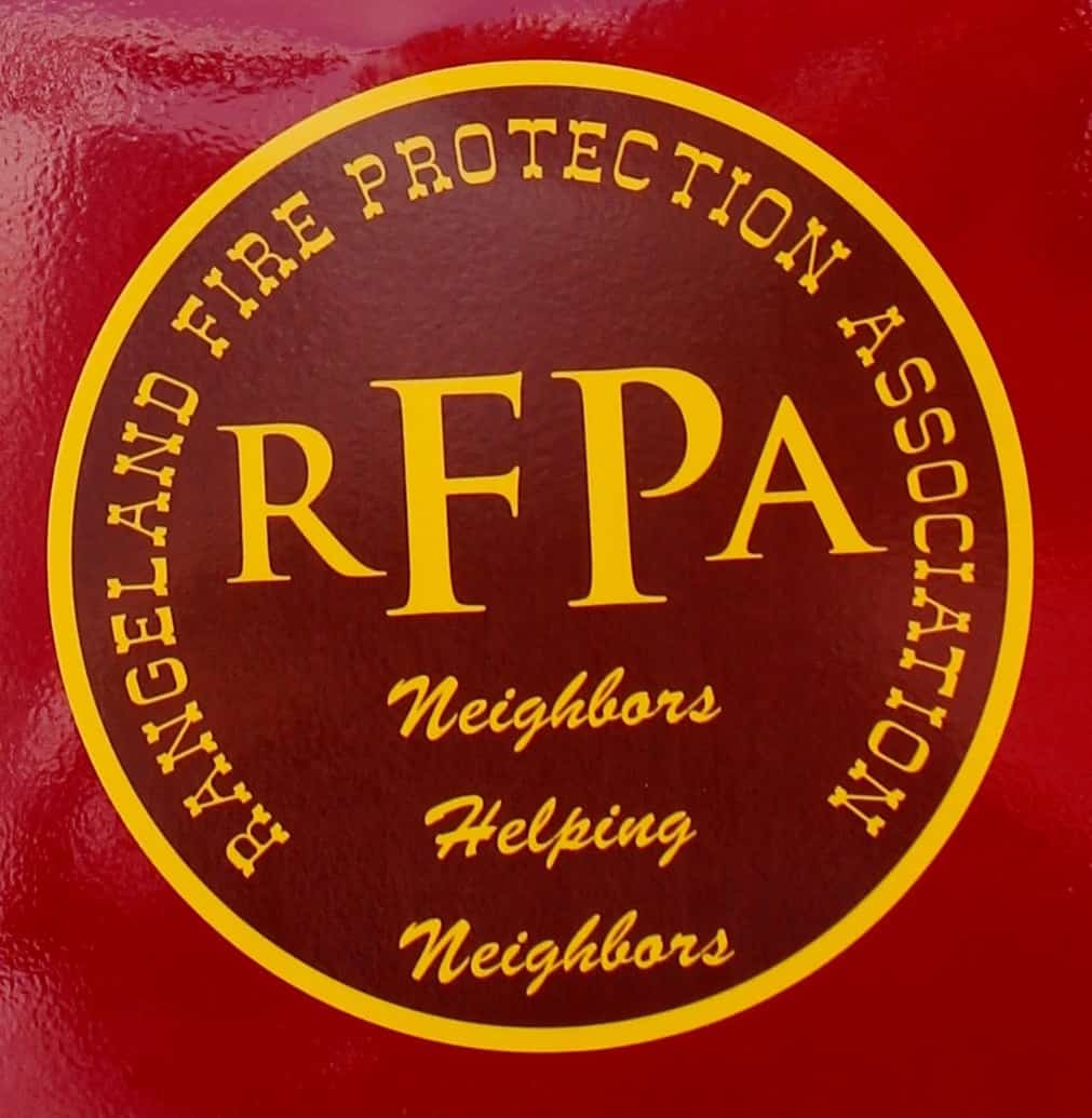 RFPA logo on a firetruck, reading: Rangeland Fire Protection Association, RFPA, Neighbors Helping Neighbors