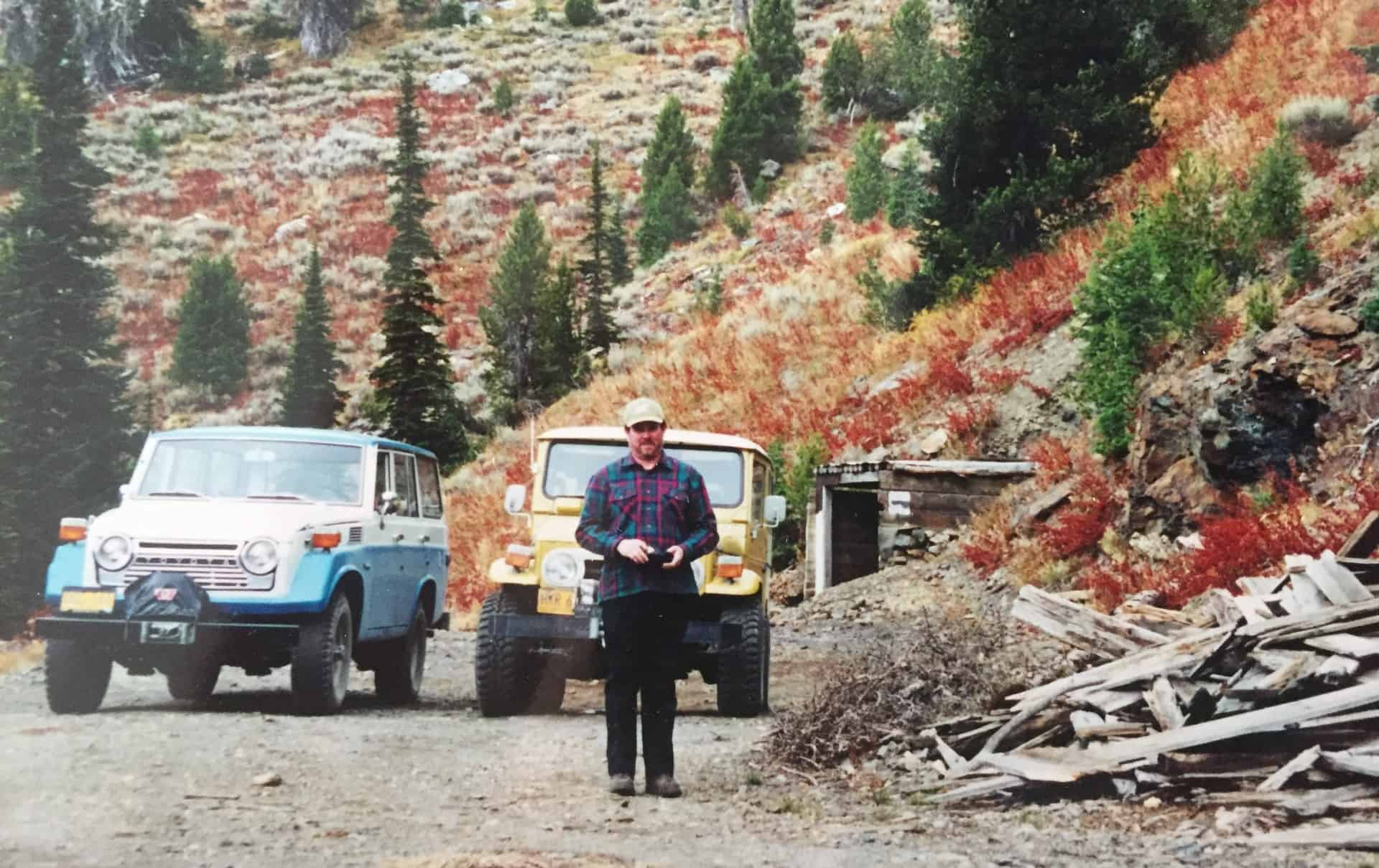 Hilary's dad next to the remains of a former mine and their family cars