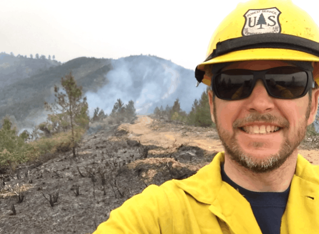 Portrait image of Lee, with wildfire smoke in the background