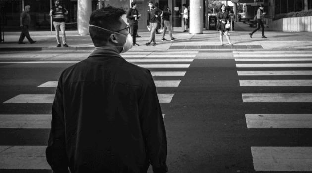 Pedestrians wearing N95 masks