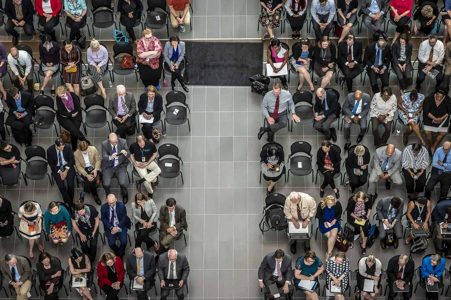 Aerial view of seated audience at a town hall.