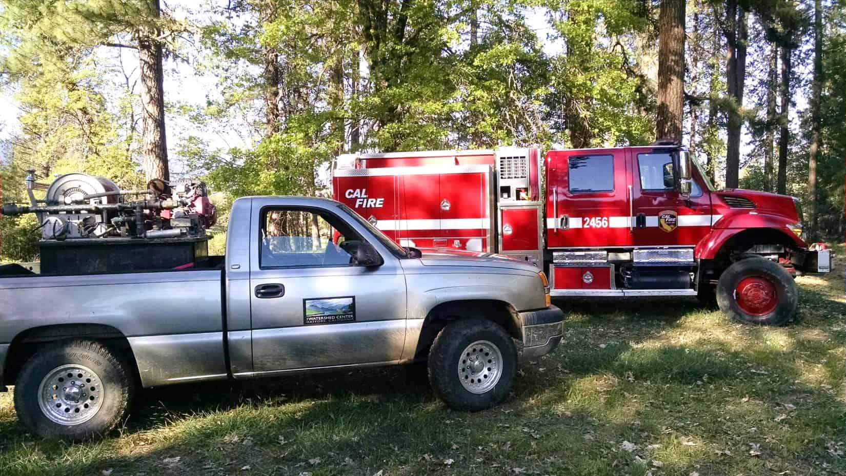A Watershed Research and Training Center truck and a CAL FIRE truck