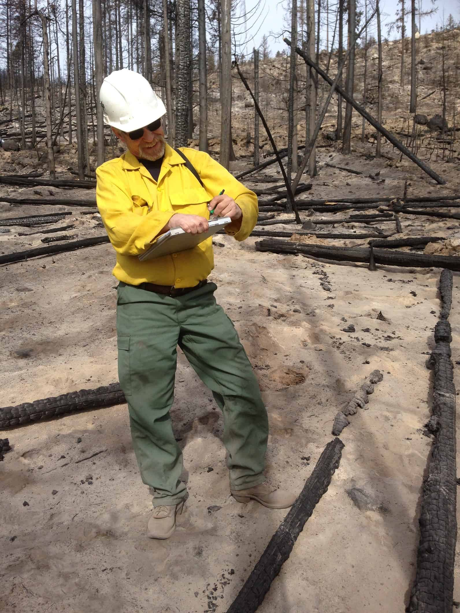 Crew member recording information in the field