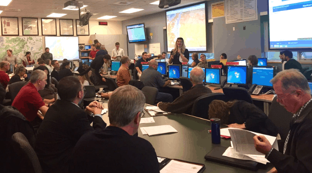 Briefing among emergency management practitioners in an Emergency Operations Center
