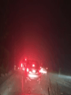 Black sky and taillights during daytime evacuation