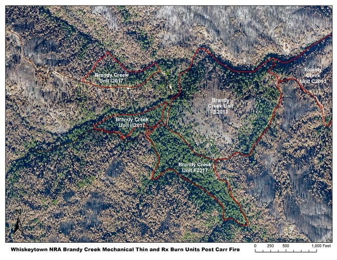 Aerial view of a portion of the Carr Fire burn area, with recent fuels treatments also delineated. The units burned in 2017 appear less damaged by the Carr Fire than those treated in 2013.
